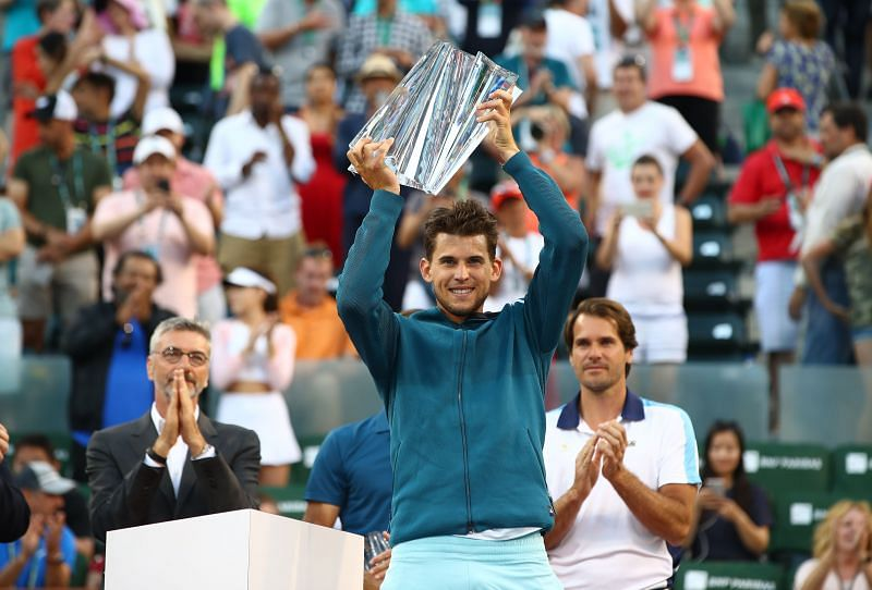 Dominic Thiem hoisting the trophy at Indian Wells 2019, with Tournament Director Tommy Haas (R) looking on