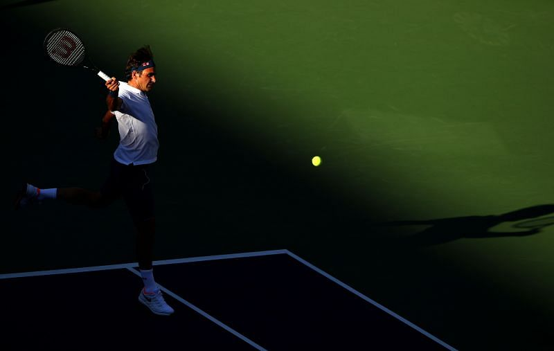Roger Federer striking a backhand.