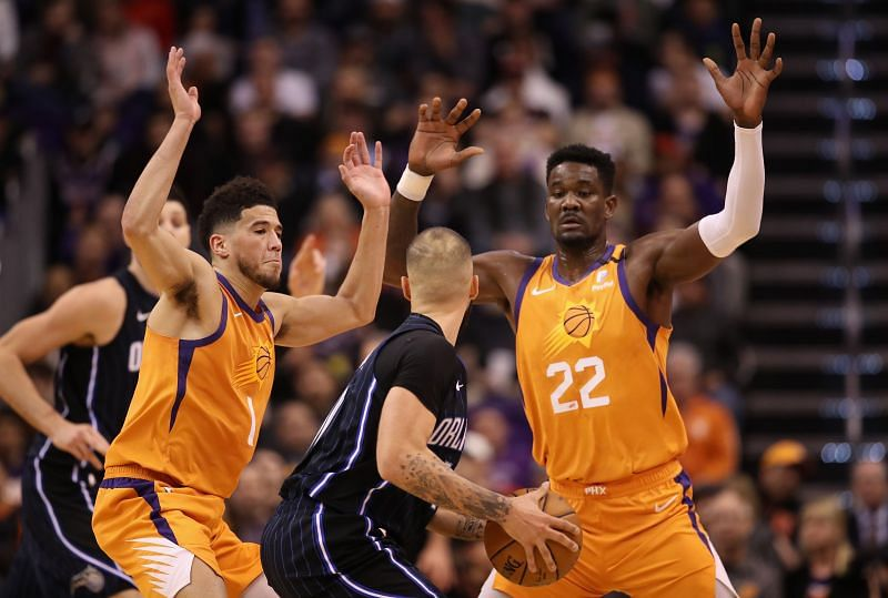 Devin Booker (#1) and Deandre Ayton (#22) of the Phoenix Suns
