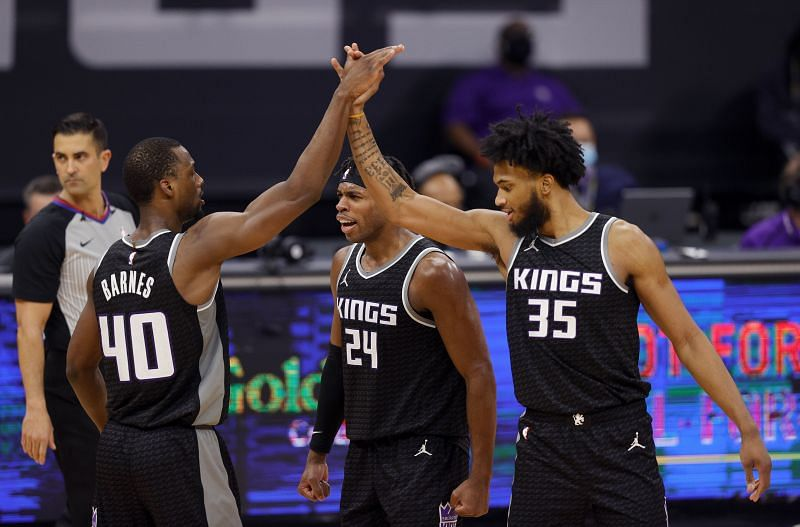 Harrison Barnes #40 is congratulated by Buddy Hield #24 and Marvin Bagley III #35. (Photo by Ezra Shaw/Getty Images)