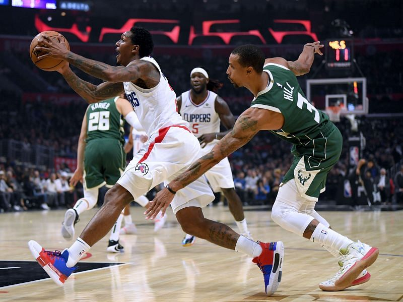 George Hill (R) in action against the LA Clippers during the 2019-20 campaign