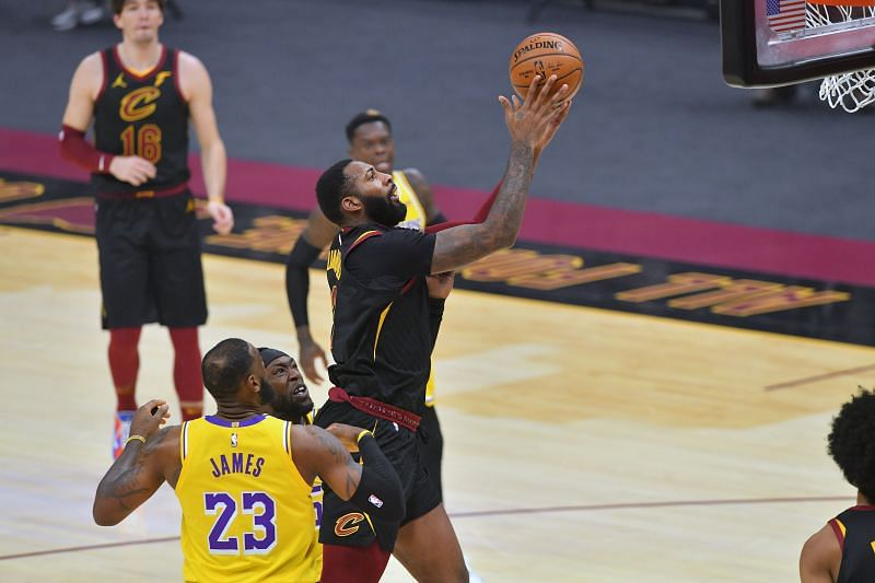 Andre Drummond #3 of the Cleveland Cavaliers shoots over LeBron James #23 of the Los Angeles Lakers