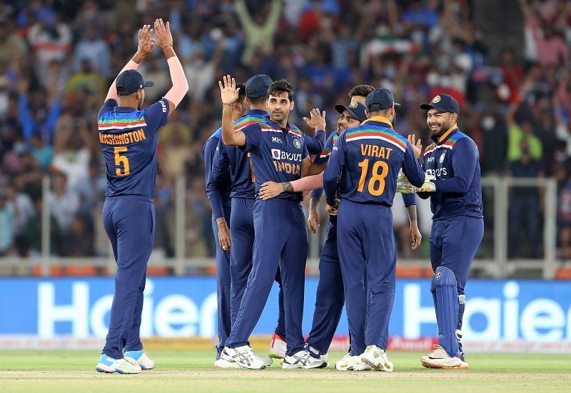 Bhuvneshwar Kumar celebrates with his teammates during the third ODI against England.