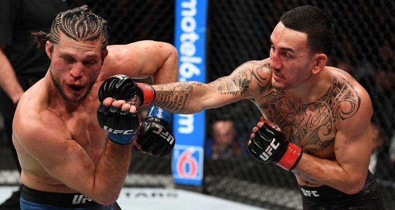 Brian Ortega lost to Max Holloway via TKO (Doctor