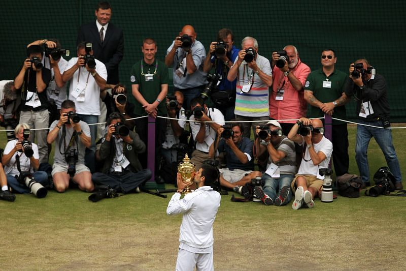 Novak Djokovic with his Wimbledon 2011 title