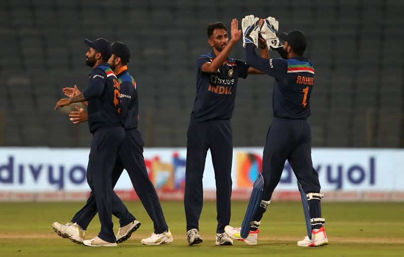 Prasidh Krishna celebrating the fall of a wicket with teammates.