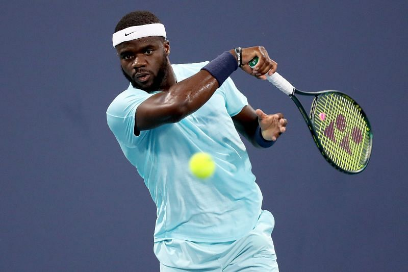 Frances Tiafoe in action against Daniel Evans in his second round match