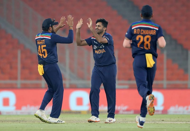 Shardul Thakur and Rohit Sharma celebrating the wicket of Eoin Morgan in the fourth T20I