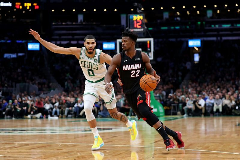 Jayson Tatum #0 defends Jimmy Butler #22. (Photo by Maddie Meyer/Getty Images)
