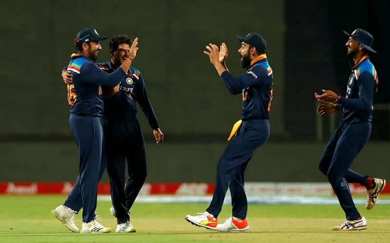 Rohit Sharma celebrates the wicket with his teammates