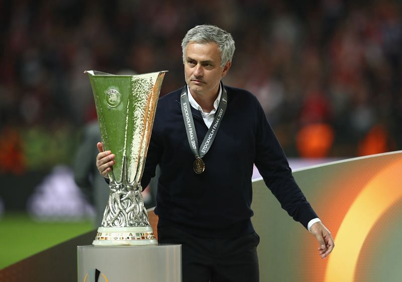 Jose Mourinho lifting the 2017 Europa League title with Manchester United