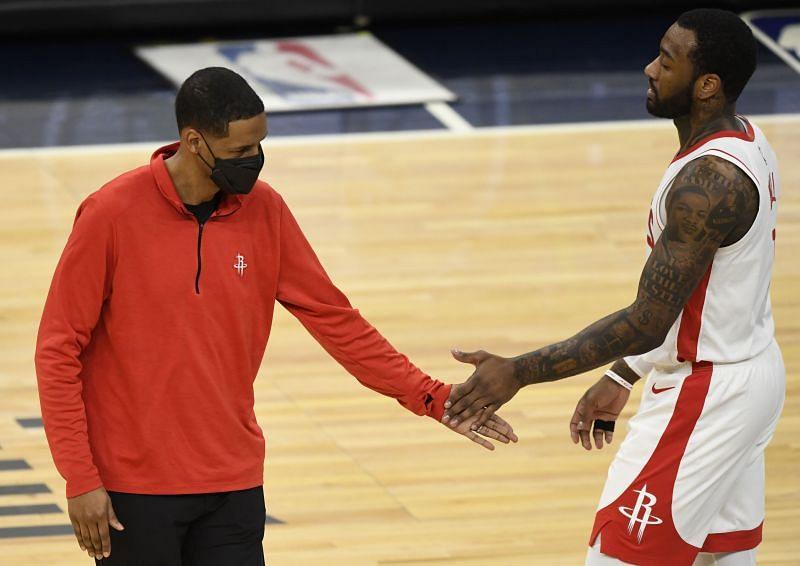 Head coach Stephen Silas of the Houston Rockets congratulates John Wall #1 during a game