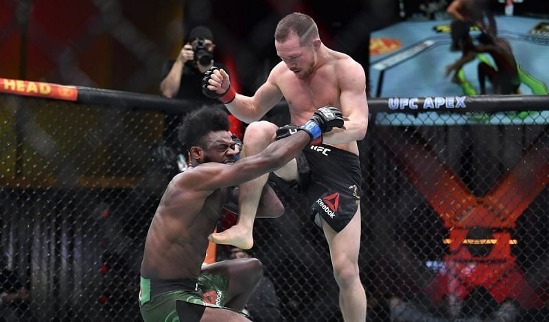Aljamain Sterling (left) was hit by Petr Yan (right) with an illegal knee at UFC 259