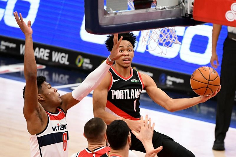 Anfernee Simons #1 of the Portland Trail Blazers drives to the basket against Rui Hachimura #8 of the Washington Wizards