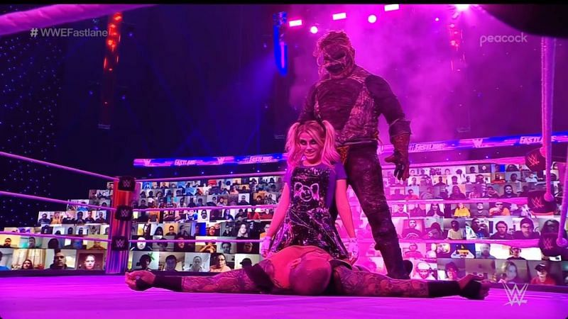 The Fiend and Alexa Bliss posing over Randy Orton