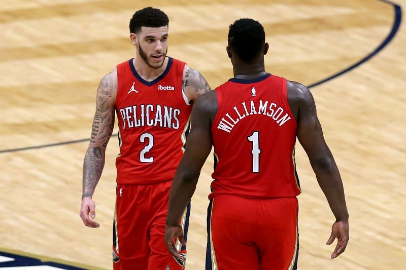 Zion Williamson #1 and Lonzo Ball #2 of the New Orleans Pelicans stand on the court during the fourth quarter of an NBA game. (Photo by Sean Gardner/Getty Images)