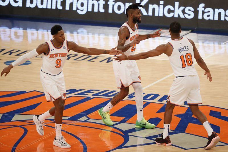 RJ Barrett (#9), Reggie Bullock (#25) and Alec Burks (#18) of the New York Knicks