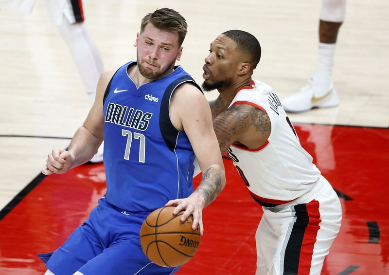 Luka Doncic is guarded by Damian Lillard