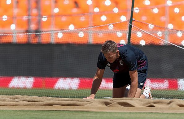 Joe Root inspects the pitch ahead of the 4th India v England Test