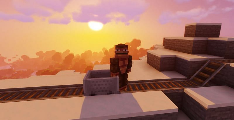 Minecarts are train-like vehicle entities that run on rails in Minecraft (Image via Minecraft)