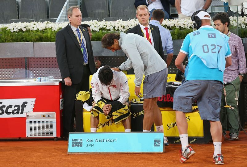 Rafael Nadal consoles Kei Nishikori at the 2014 Mutua Madrid Open Masters