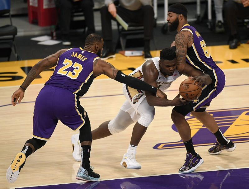 Zion Williamson #1 is fouled by LeBron James #23 (Photo by Harry How/Getty Images)