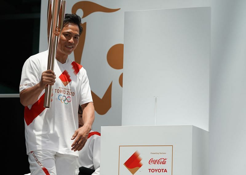 Tokyo 2020 Torch Relay Official Ambassador Tadahiro Nomura with the Olympic Games torch in June 2019 in Tokyo, Japan