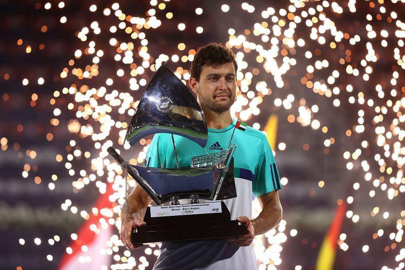 Aslan Karatsev poses with the Dubai Tennis Championships trophy