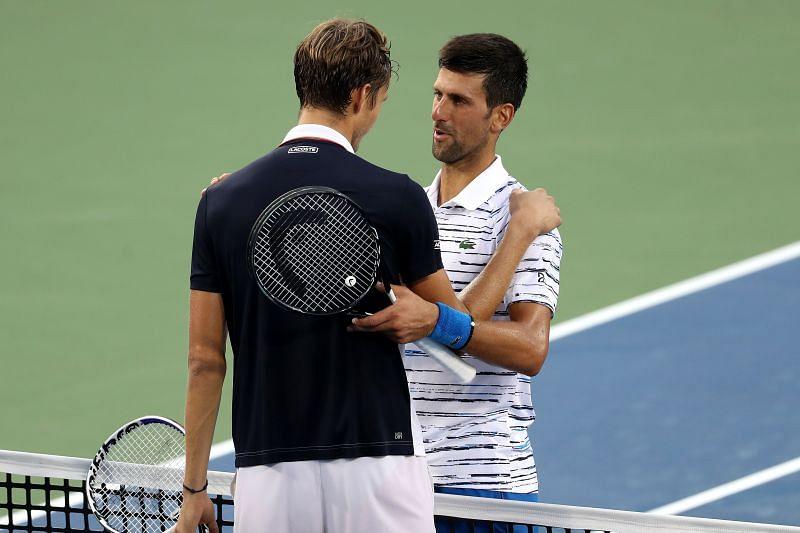 Daniil Medvedev (L) and Novak Djokovic