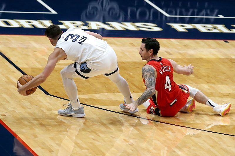 Grayson Allen #3 and JJ Redick #4 scramble for a loose ball
