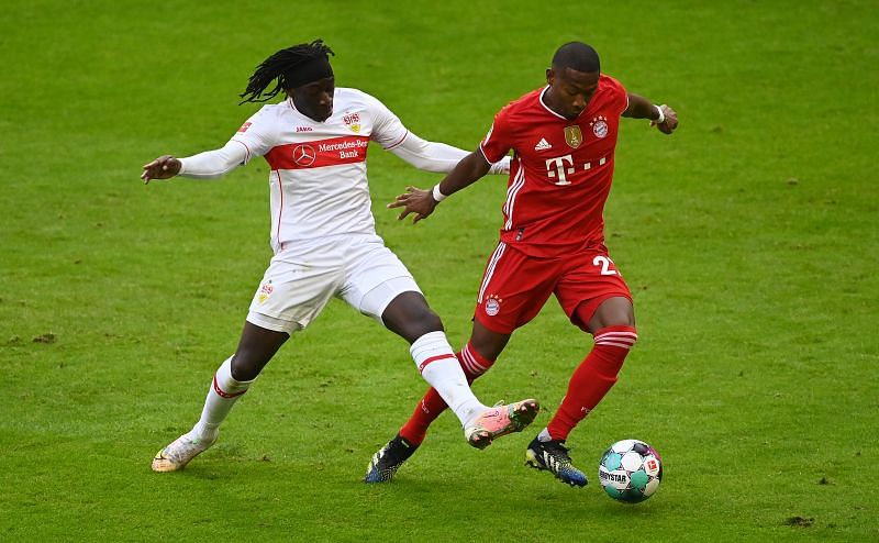 David Alaba tussles for the ball