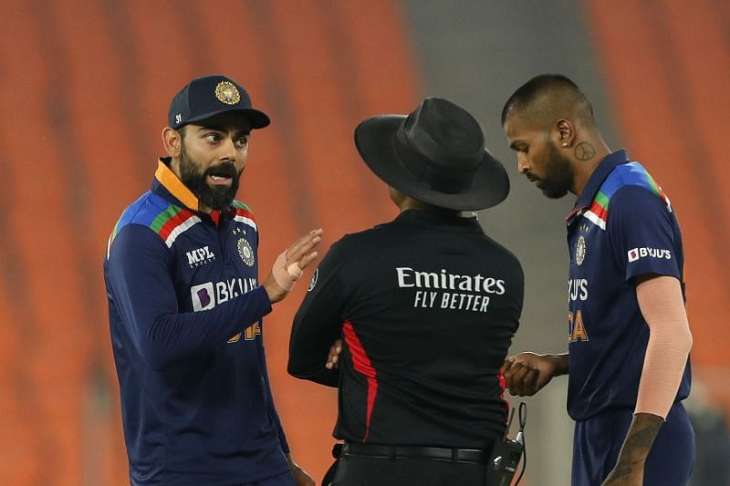 Virat Kohli engaging in a tense chat with umpire Nitin Menon after Jos Buttler