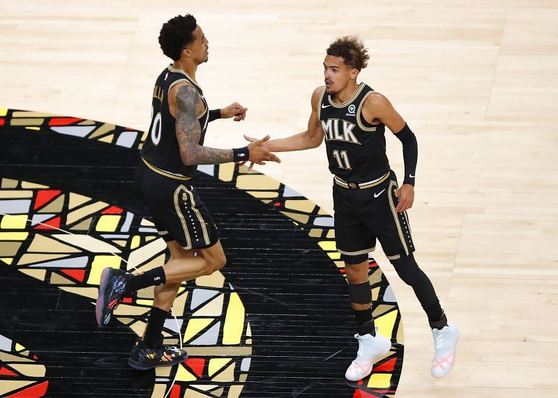 John Collins #20 reacts with Trae Young #11 during the first half against the Oklahoma City Thunder. Photo: Todd Kirkland/Getty Images.