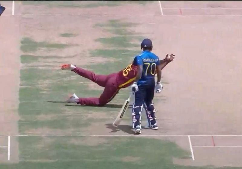 Kieron Pollard pulls off a brilliant caught and bowled to dismiss Karunaratne (Image courtesy Twitter)