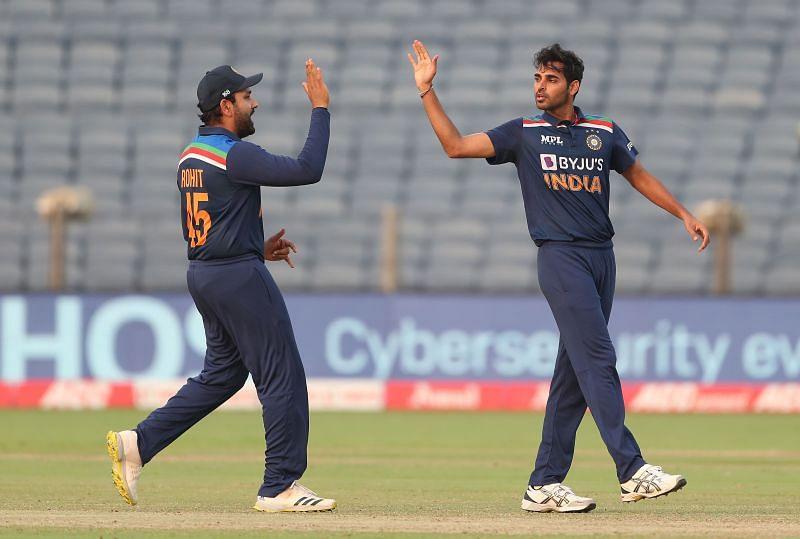 Rohit Sharma (L) & Bhuvneshwar Kumar