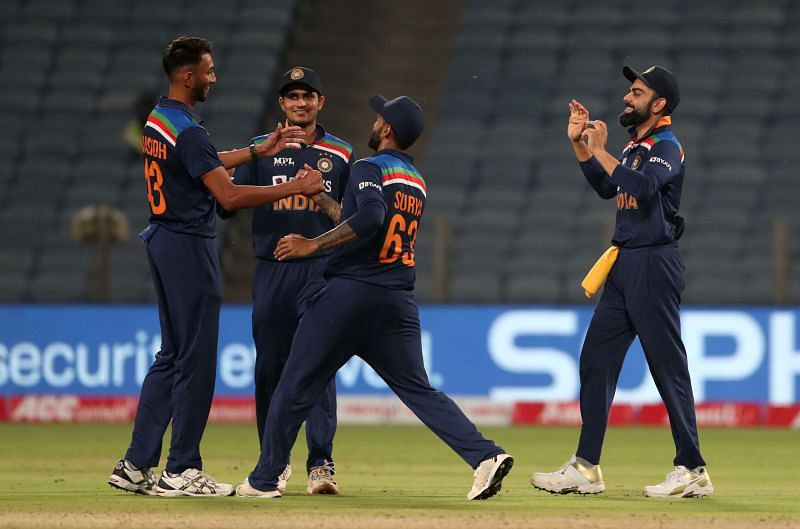 Prasidh Krishna (left) celebrating the fall of an England wicket in Pune.