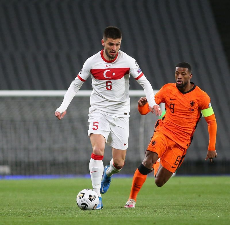 Georginio Wijnaldum (R) tussles it out for the ball
