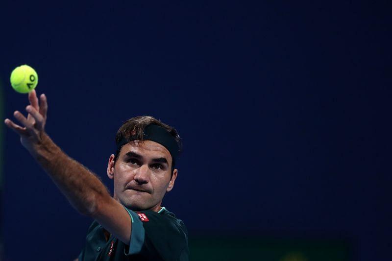Roger Federer serves at the 2021 Qatar Open