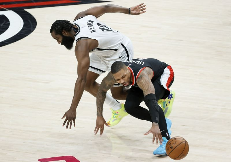 Damian Lillard #0 is pressured by James Harden #13. Photo: Steph Chambers/Getty Images.