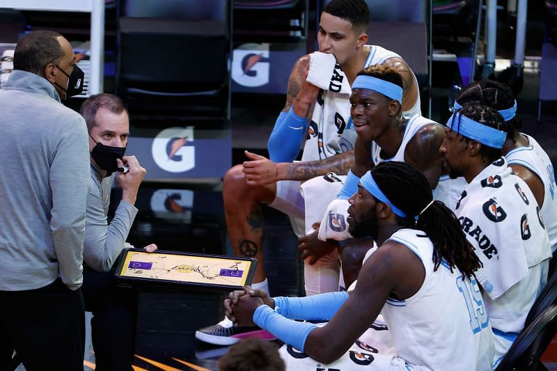 Head coach Frank Vogel talks with Kyle Kuzma #0, Dennis Schroder #17 and Montrezl Harrell #15. (Photo by Christian Petersen/Getty Images)