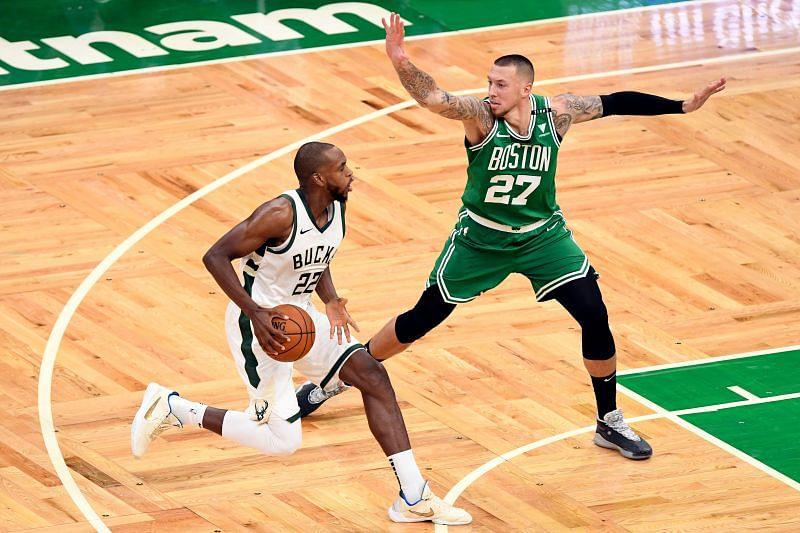 Khris Middleton of the Milwaukee Bucks and Daniel Theis of the Boston Celtics