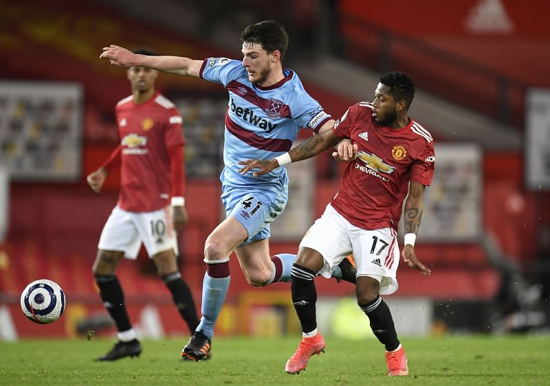 Declan Rice tussles with Fred