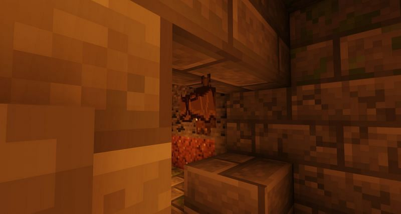 A bat hanging on a Stronghold doorway (Image via Minecraft)
