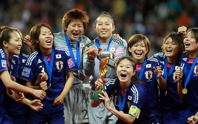 Homara Sawa, of Japan, lifts the trophy after the FIFA Women