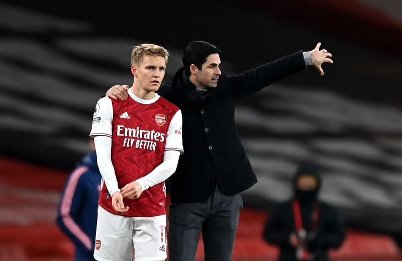 Martin Odegaard (left) and Mikel Arteta