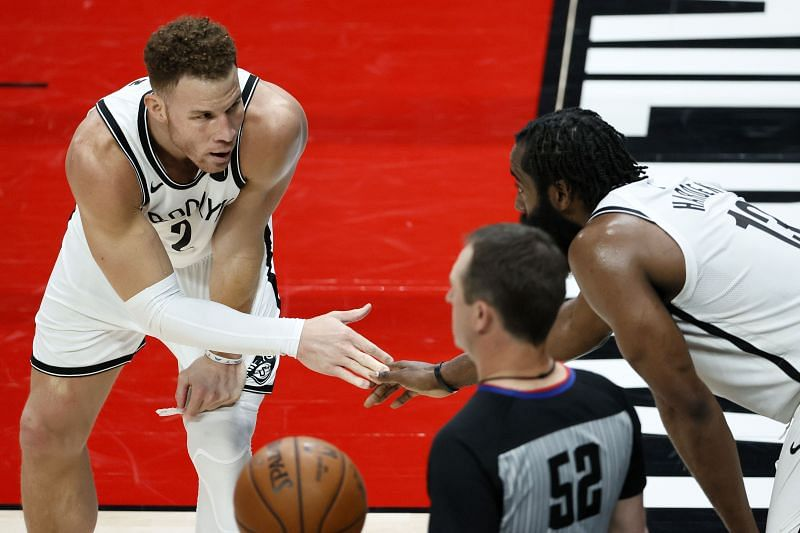 Blake Griffin #2 and James Harden #13 slap hands during a stoppage in play. Photo: Steph Chambers/Getty Images.