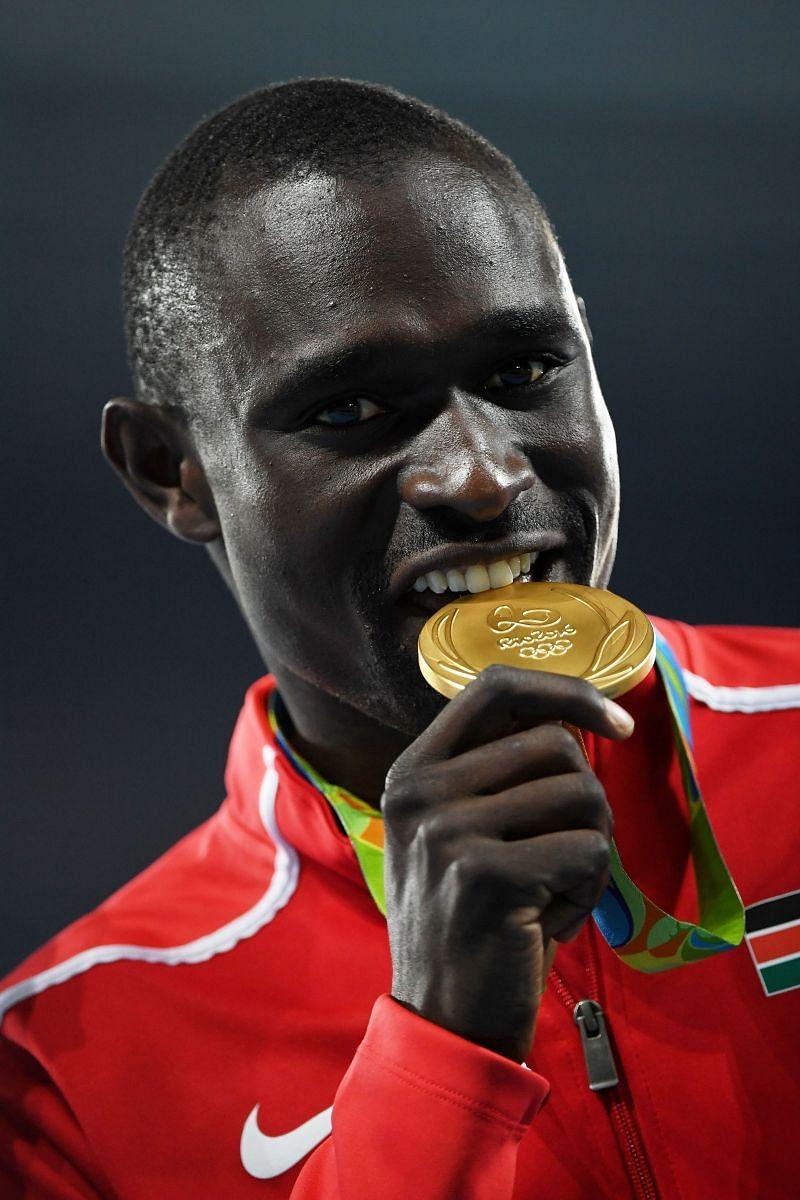 Gold medalist David Lekuta Rudisha of Kenya poses during the medal ceremony for the Men