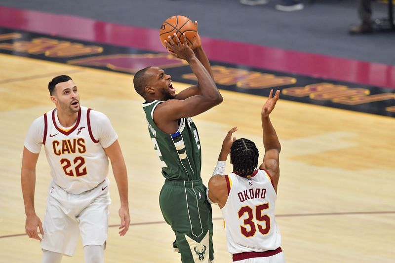 Khris Middleton #22 shoots a jump shot over Isaac Okoro #35 and Larry Nance Jr. #22. (Photo by Jason Miller/Getty Images)