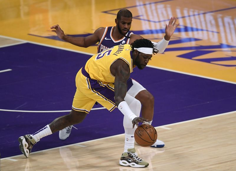 Montrezl Harrell #15 loses the ball as he is guarded by Chris Paul #3. (Photo by Harry How/Getty Images)