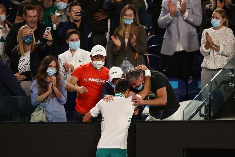Novak Djokovic celebrates with his team after winning the 2021 Australian Open
